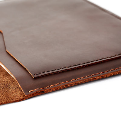 Detail from the handmade stitching from a Brown leather case