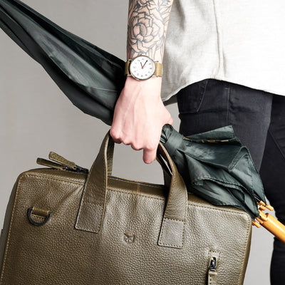 Roko green briefcase with umbrella. Style picture for briefcase by Capra Leather.