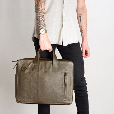 Style front picture handles holding Roko green briefcase.