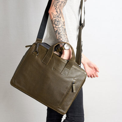 Style hand inside briefcase. Roko green by Capra Leather.