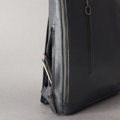 Integrated pencil pocket detail. Men's modern slim backpack by Capra Leather.