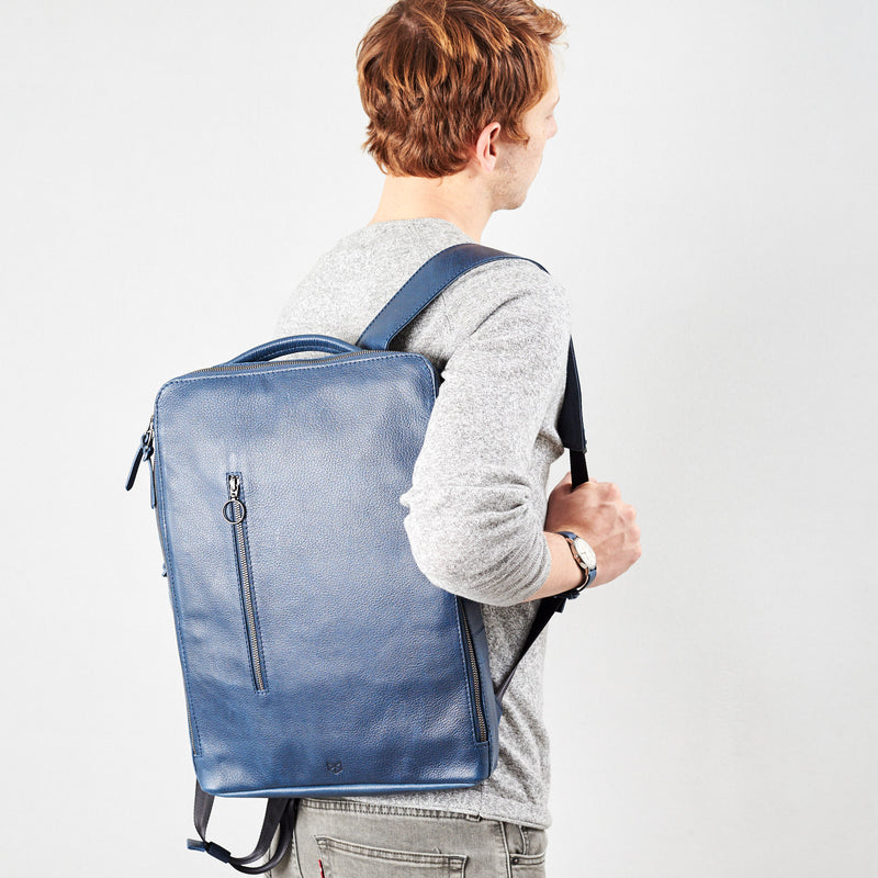 Front image Saola tech backpack in blue leather. Modern minimalistic bag by Capra Leather.