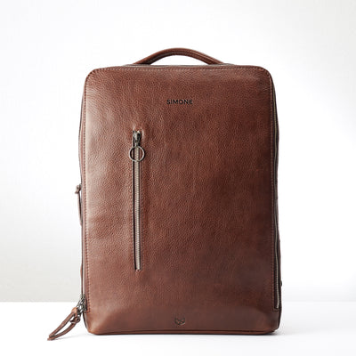 Engraving detail in brown leather. Modern Saola tech bag by Capra Leather
