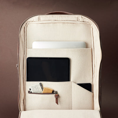 Interior of brown leather slim tech backpack. Laptop, tablet and cellphone organization for everyday use.