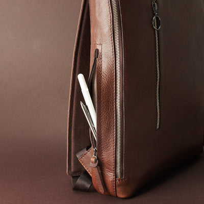 Interior pencil pocket detai in brown leather. Men's modern slim backpack by Capra Leather.