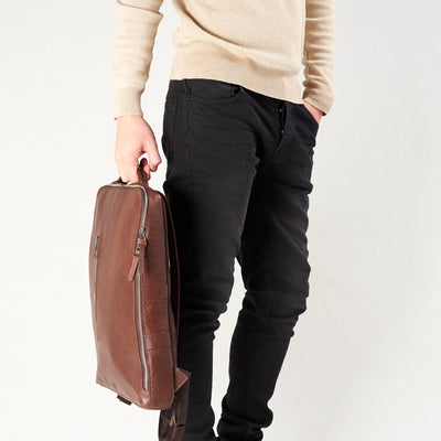 Style handle holding slim backpack in brown leather. Organization laptop backpack for men by Capra Leather.