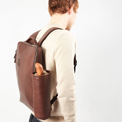 Style with detachable pouch in brown leather. Water bottle and umbrella pouch made by Capra Leather.