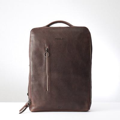Engraving detail in dark brown leather. Modern Saola tech bag by Capra Leather