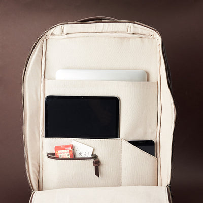 Interior of dark brown leather slim tech backpack. Laptop, tablet and cellphone organization for everyday use.