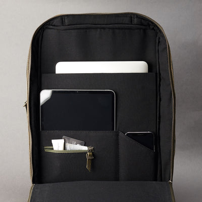 Interior of green leather slim tech backpack. Laptop, tablet and cellphone organization for everyday use.