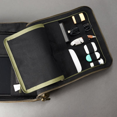 Discreet tech essentials organizer open in green leather. Tech laptop bag by Capra Leather.