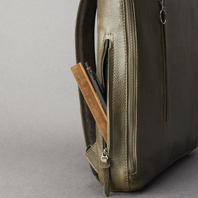 Interior pencil pocket detai in green leather. Men's modern slim backpack by Capra Leather.