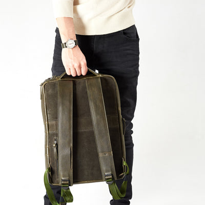 Style handle holding slim backpack in green leather. Organization laptop backpack for men by Capra Leather.