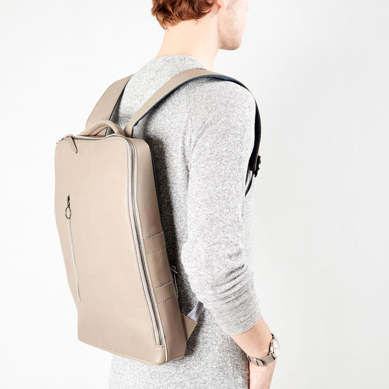 Front image Saola tech backpack in grey leather. Modern minimalistic bag by Capra Leather.