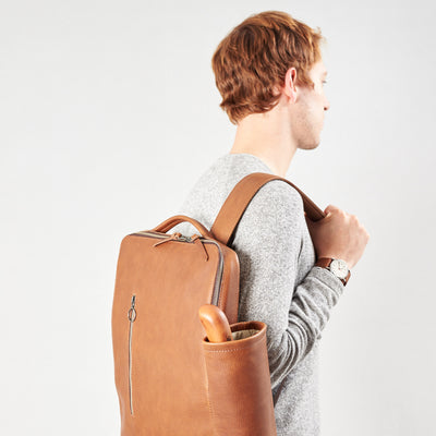 Style with detachable pouch in tan leather. Water bottle and umbrella pouch made by Capra Leather.