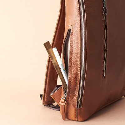 Interior pencil pocket detai in tan leather. Men's modern slim backpack by Capra Leather.
