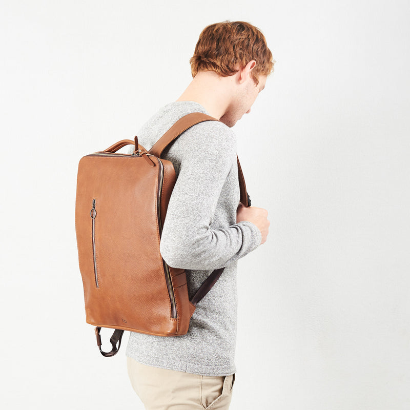 Front image Saola tech backpack in tan leather. Modern minimalistic bag by Capra Leather.