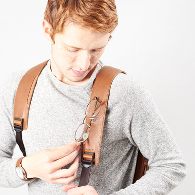 Style glasses holder detail in tan leather. Organization laptop backpack for men by Capra Leather.