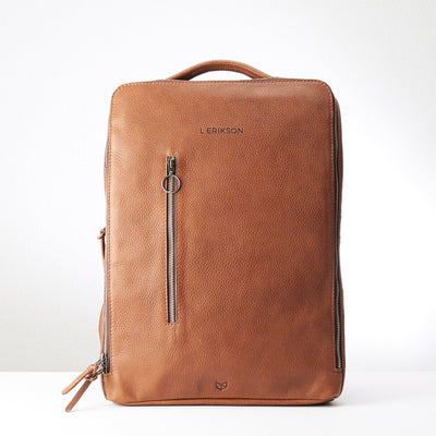 Engraving detail in tan leather. Modern Saola tech bag by Capra Leather