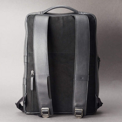 Back view Saola tech backpack in black leather. Modern minimalistic bag by Capra Leather.