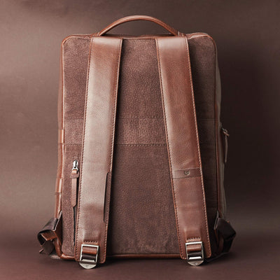 Back view Saola tech backpack in brown leather. Modern minimalistic bag by Capra Leather.