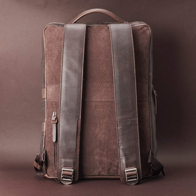 Back view Saola tech backpack in dark brown leather. Modern minimalistic bag by Capra Leather.