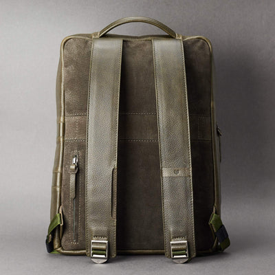 Back view Saola tech backpack in green leather. Modern minimalistic bag by Capra Leather.