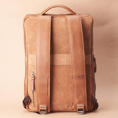 Back view Saola tech backpack in tan leather. Modern minimalistic bag by Capra Leather.