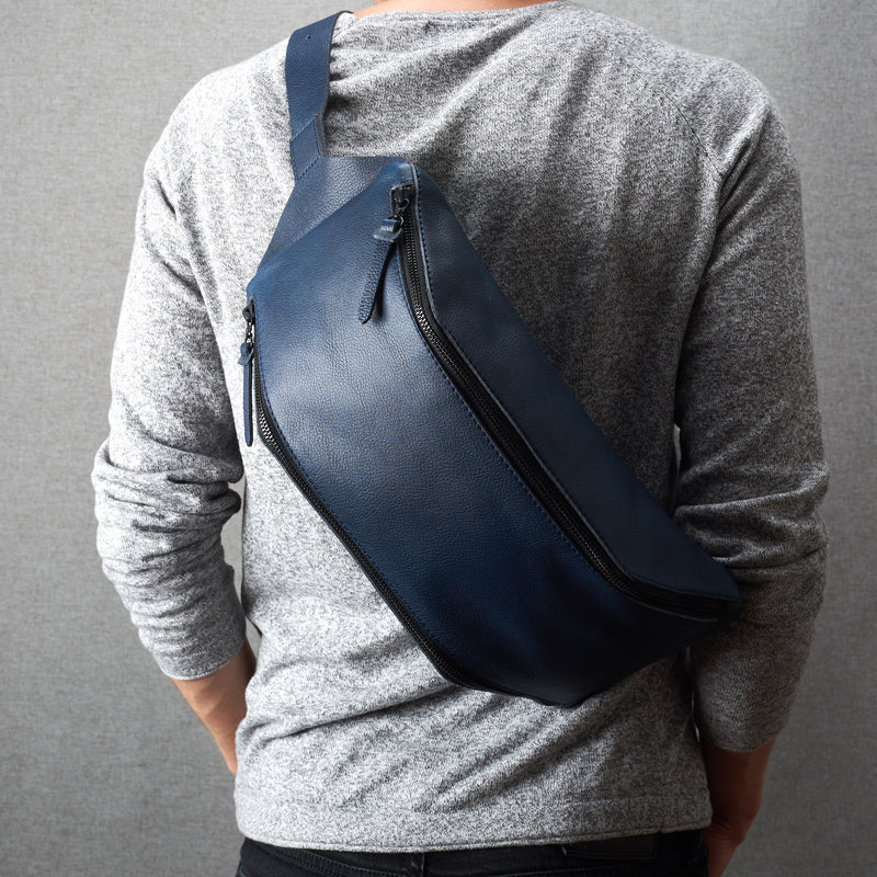 Front view leather. Fenek blue sling bag by Capra Leather. Handmade men messenger backpack.