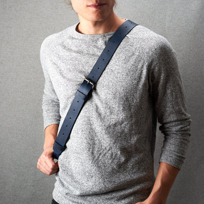 Styling shoulder strap. Fenek blue sling bag for men by Capra Leather. Bicycle backpack, everyday carry messenger bag.