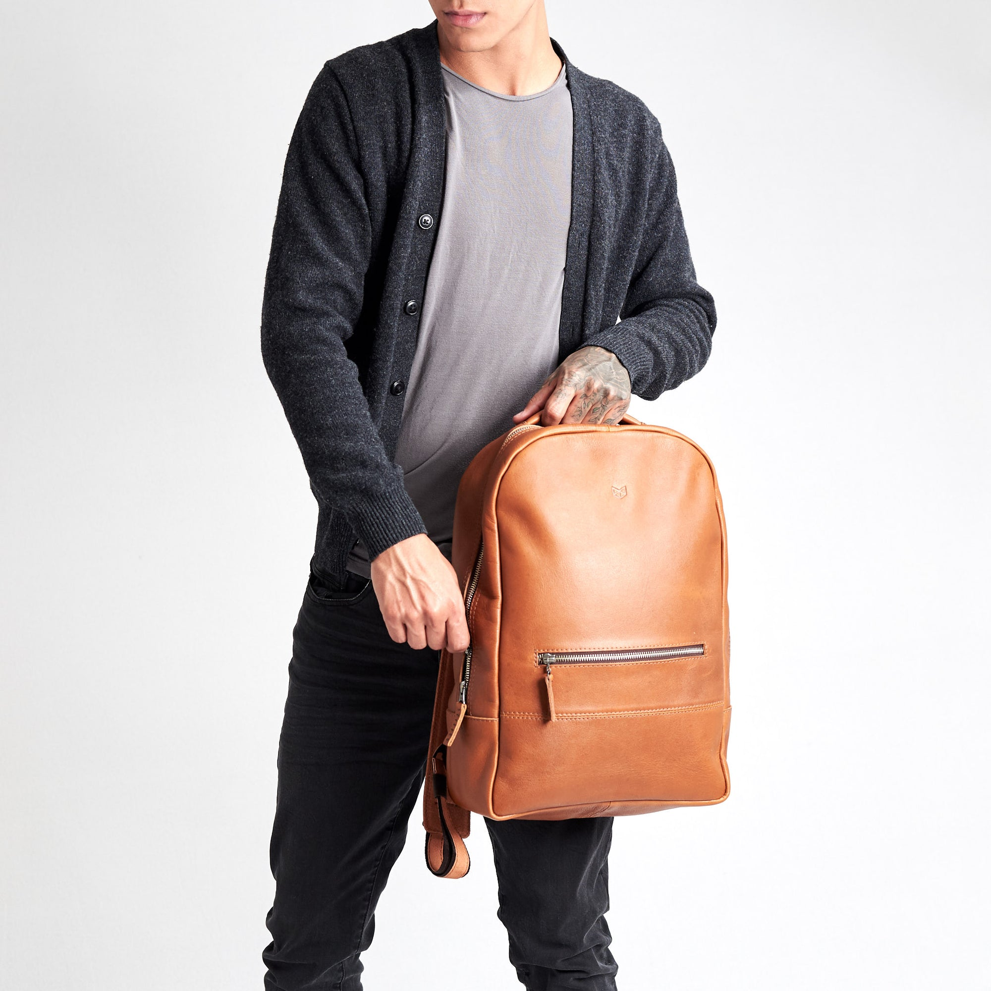 Minimalist tan leather backpack for men. Handmade full grain leather rucksack