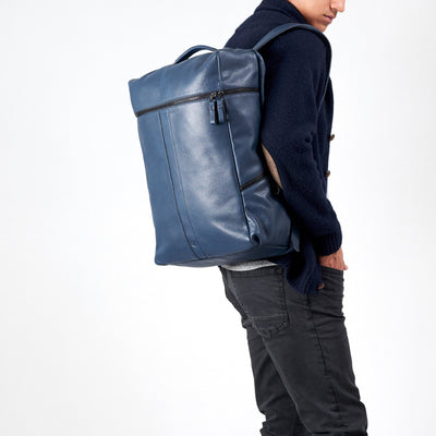Style front view model wearing Banteng backpack. Blue rucksack by Capra Leather.