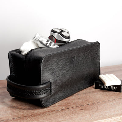 Dopp kit and toiletries. Black leather toiletry, shaving bag with hand stitched handle
