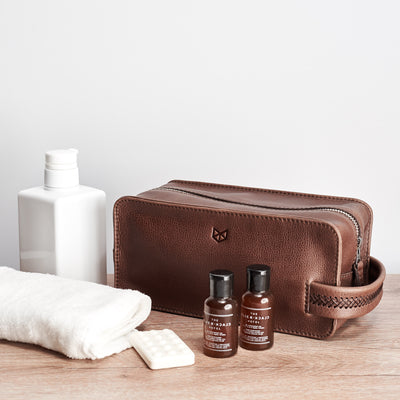Dopp kit and toiletries. Brown leather toiletry, shaving bag with hand stitched handle
