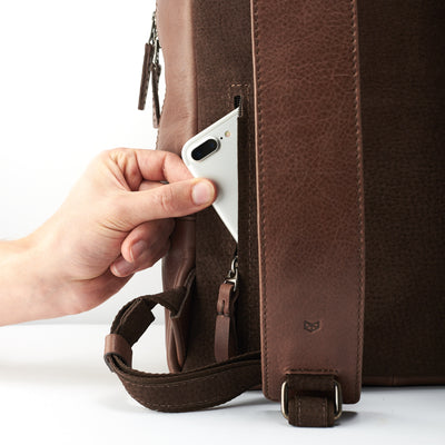 Hidden back pocket. Minimalist brown leather backpack for men.