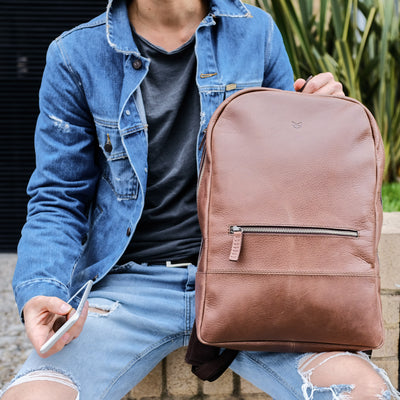 Style street photo. Unique designer brown leather backpack for men.