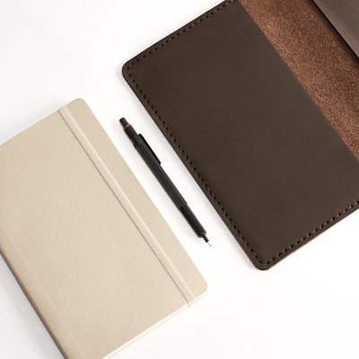 Style. Entirely hand stitched Moleskine Large and Pocket leather cover. Traveler's journal case. Customize your notebook with our handmade case.