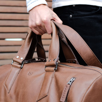 Hand stitched handles. Handmade brown leather athletic work out bag