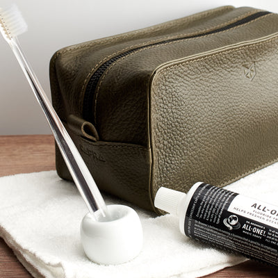 Style. Green leather toiletry, shaving bag with hand stitched handle. Groomsmen gifts