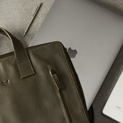 Style. Green leather briefcase for men. Office style mens workbag