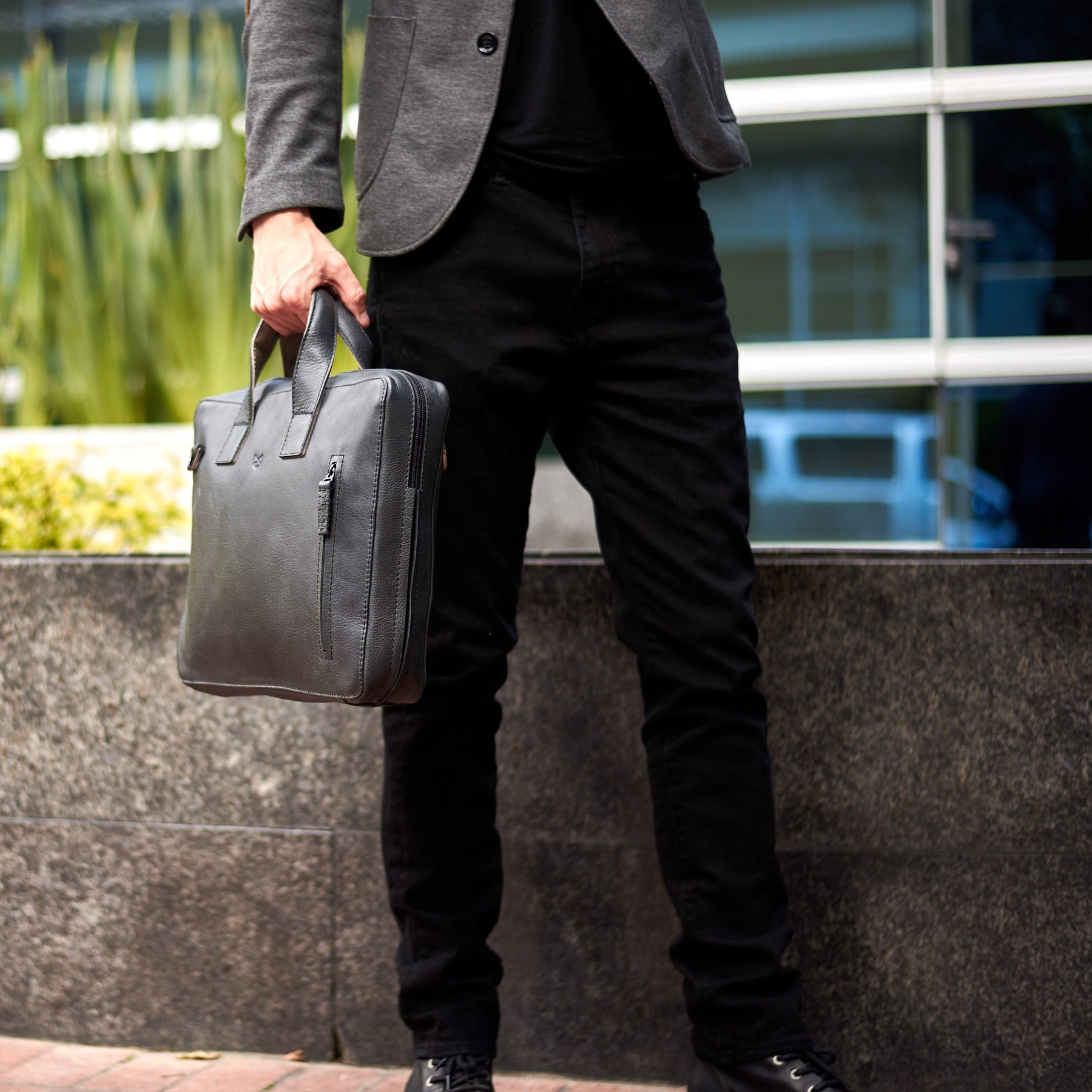 Front. Black leather soft briefcase for men. Unique mens workbag
