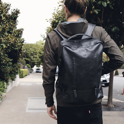 Style street look. Black leather backpack for men. Personalized gifts for men
