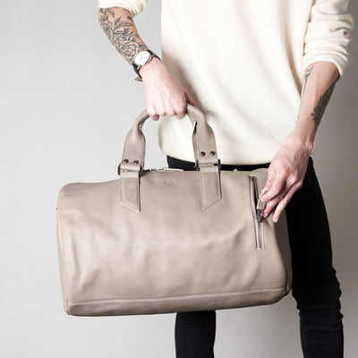 Style front pocket. Substantial grey duffle bag by Capra Leather.