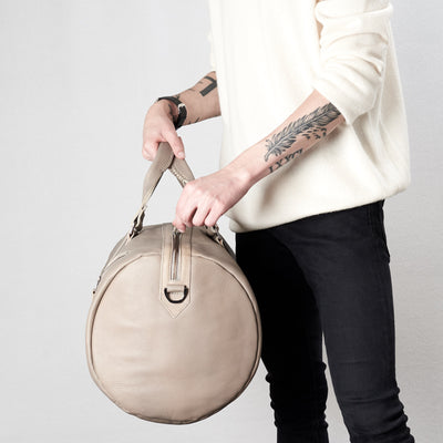 Style zipper tabs. Substantial grey duffle bag by Capra Leather.