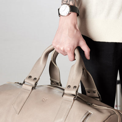 Style handles detail. Substantial grey duffle bag by Capra Leather.