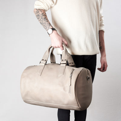 Style. Substantial grey duffle bag by Capra Leather.