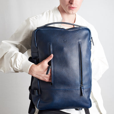 Blue Tamarao backpack. Style picture front pocket detail.