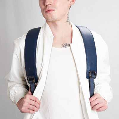 Shoulder straps styling picture. Tamarao blue backpack by Capra Leather.