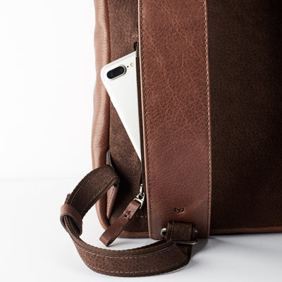 hidden back pocket. Brown leather backpack for men