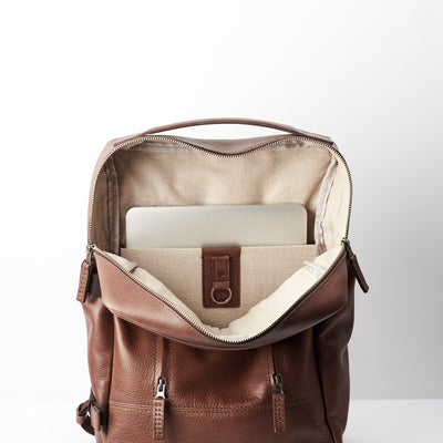 15 inch Macbook pro pocket. Brown leather backpack with linen interior